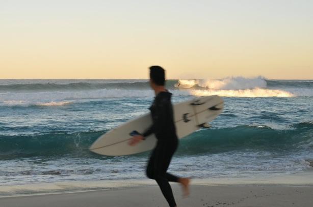 Surfer Looks On In Envy